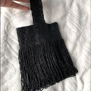Black hand beaded purse.
